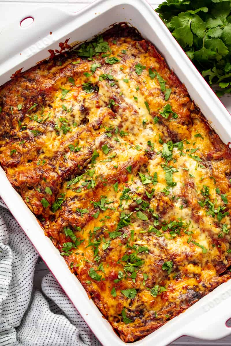 Beef Enchiladas in a ceramic baking dish.