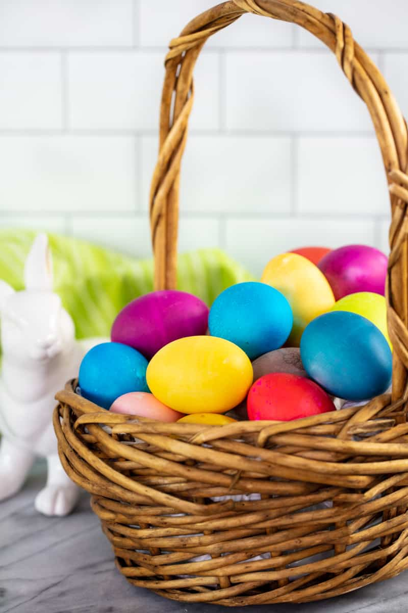 A basket full of dyed eggs.