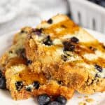 Blueberry Pancake Bread slices with syrup on them.