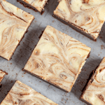 Bird's eye view of Cheesecake Brownies cut into squares.