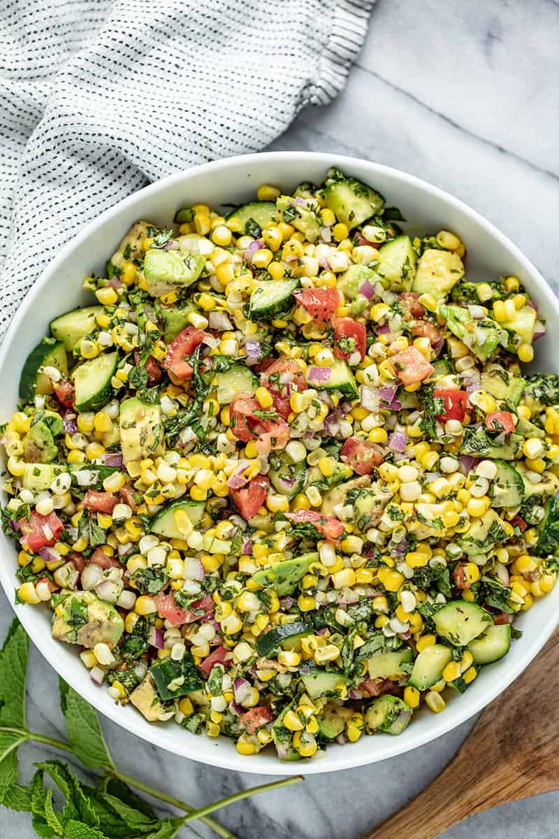 Bird's eye view of Corn Salad in a white bowl.