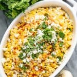 Bird's eye view of Mexican Street Corn Salad in a white dish.