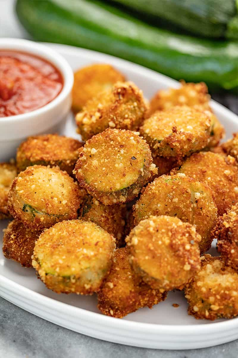 Close up of Parmesan Fried Zucchini on a serving plater.