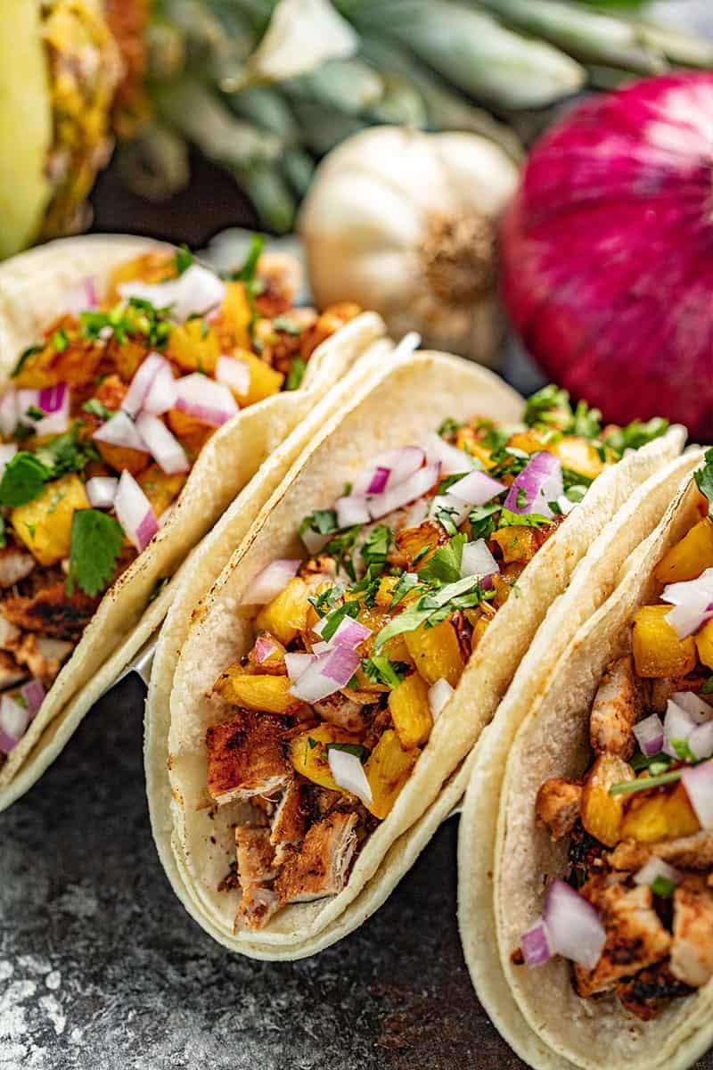 Tacos Al Pastor in a taco holder.
