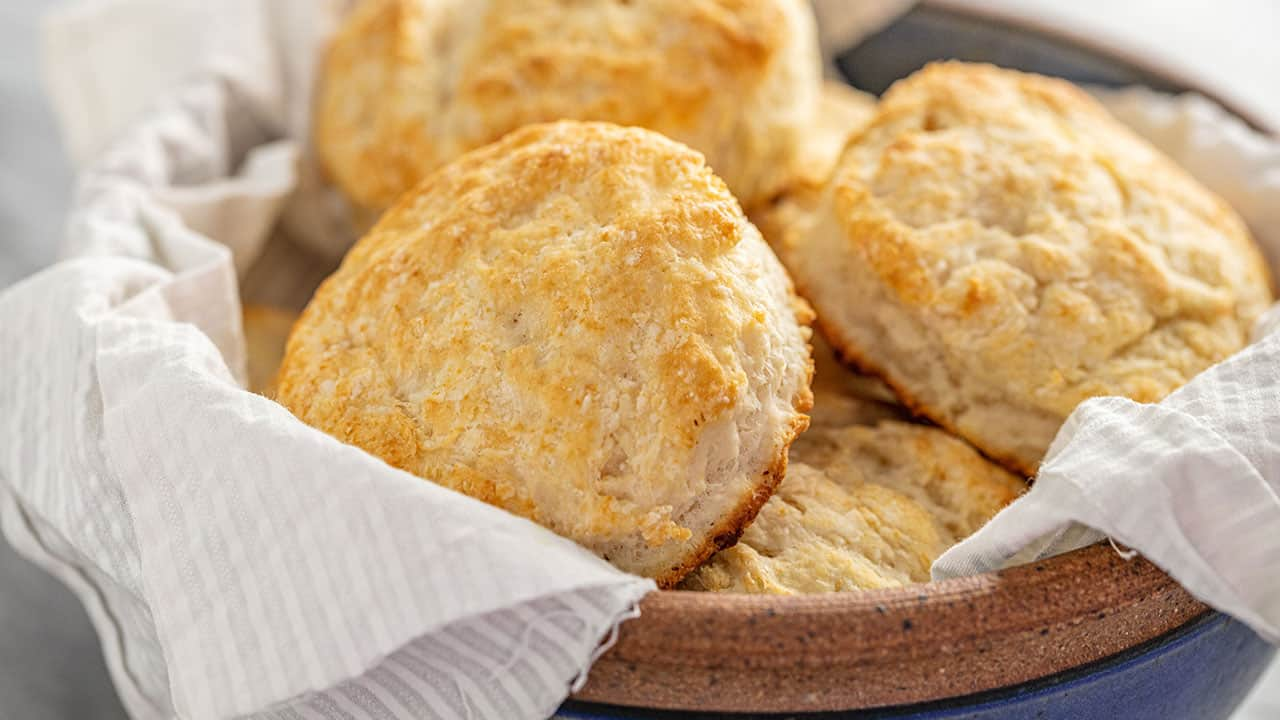 A bowl of freshly baked Flaky Old Fashioned Biscuits