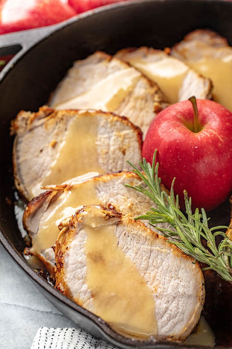 Pork Loin Roast with Apple Glaze in a cast-iron skillet.