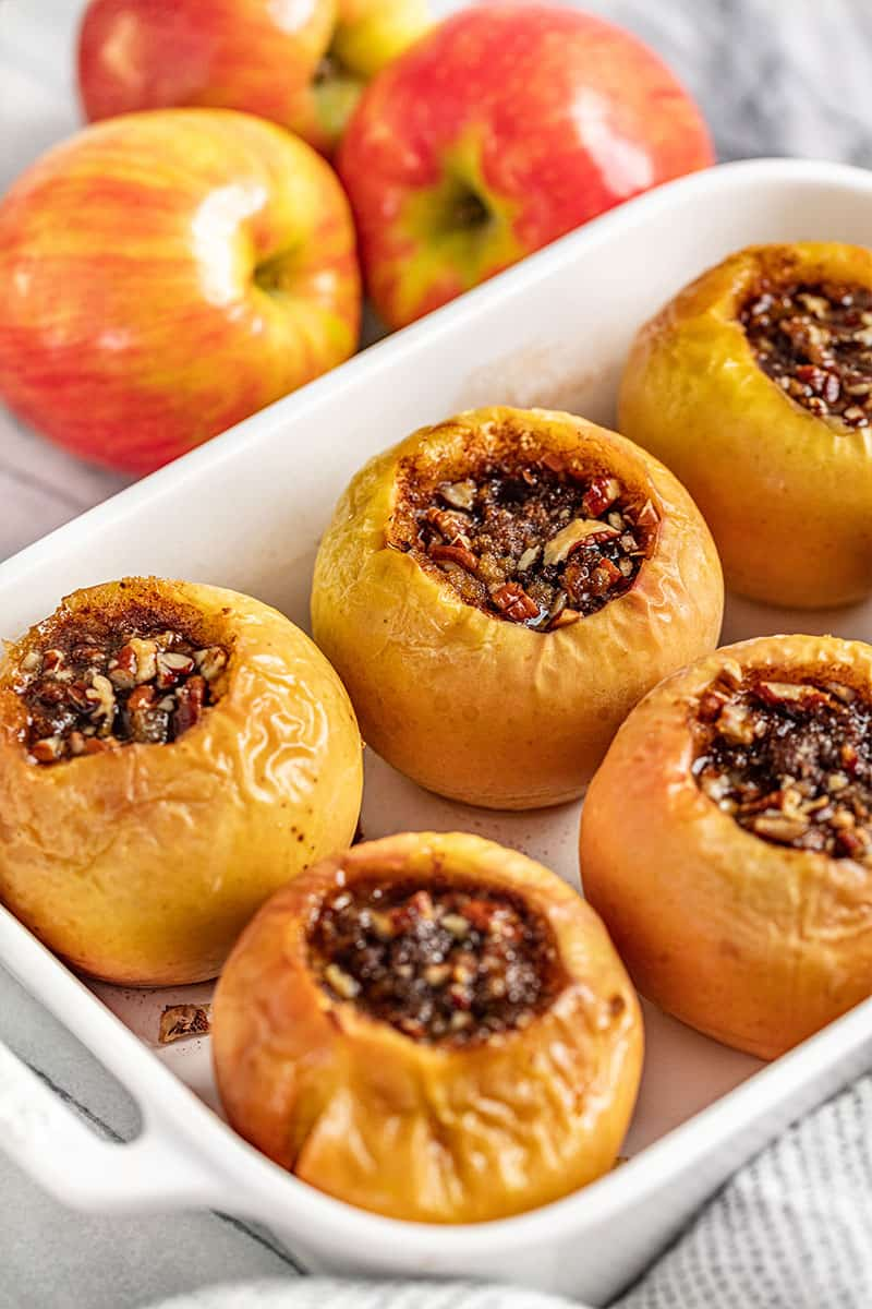 Baked Apples in a white baking dish.