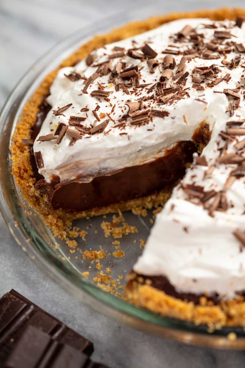 Chocolate cream pie with a slice cut out