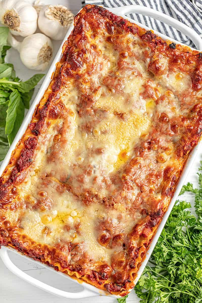 Lasagna in a white baking dish