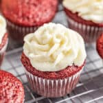 Red Velvet Cupcakes with Ermine Icing on a wire cooling rack