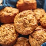 Bran muffins in a basket with a blue cloth