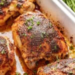 Crispy oven baked chicken thighs in white baking dish