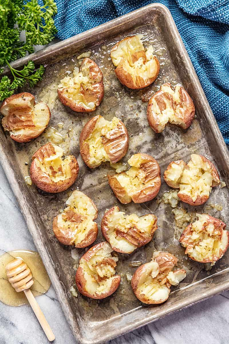 Honey roasted smashed potatoes on sheet pan