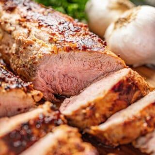 Roasted pork tenderloin sliced on a platter