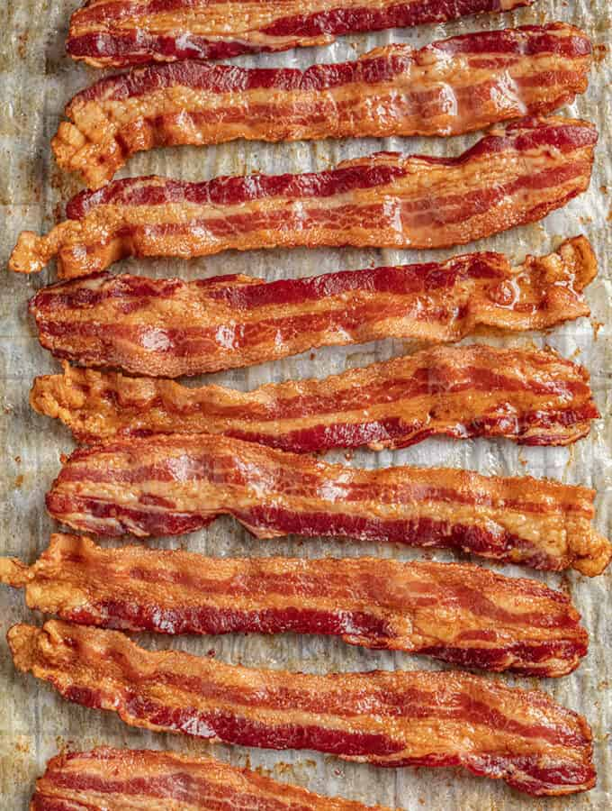 Oven cooked bacon on parchment paper