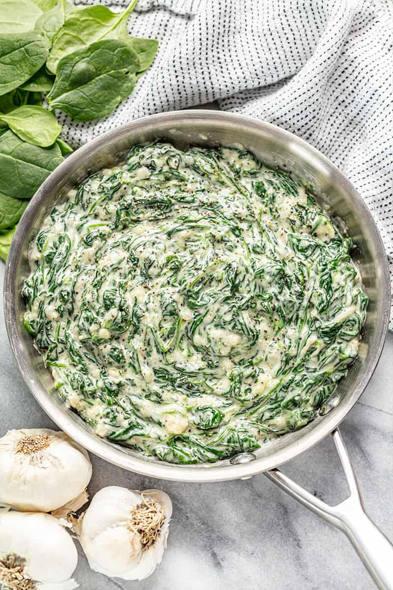 Creamed spinach in a stainless steel skillet