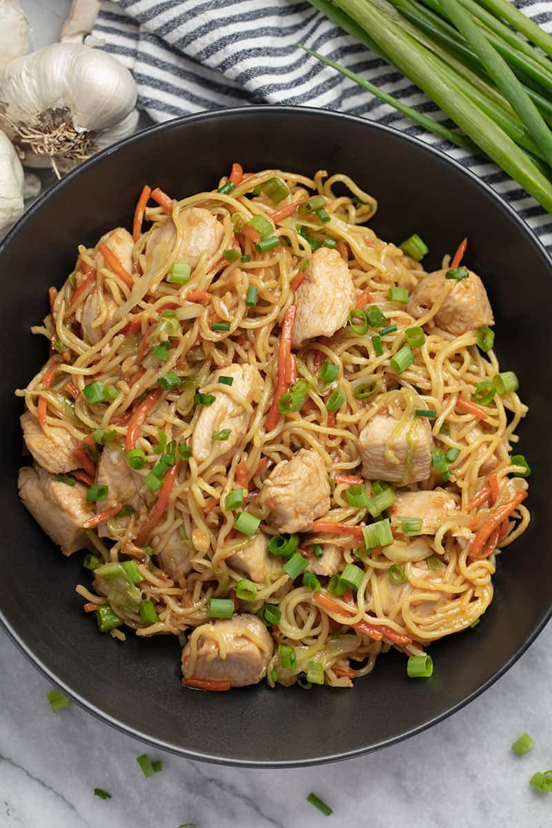 Chicken chow mein in a black bowl
