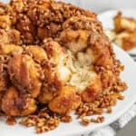 Gooey caramel pecan monkey bread with a chunk missing.