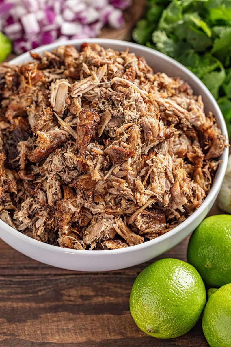 Crockpot carnitas in a white bowl