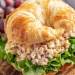 Ham salad on a flaky croissant with romaine lettuce