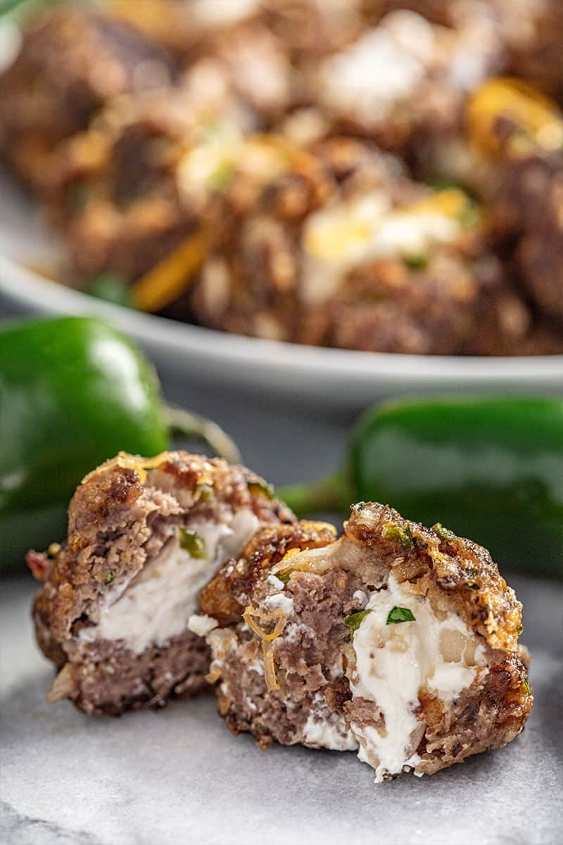 Jalapeno popper meatball cut in half with cream cheese oozing out