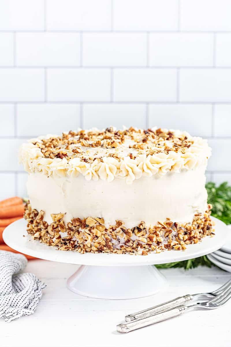 Carrot cake on a white cake platter