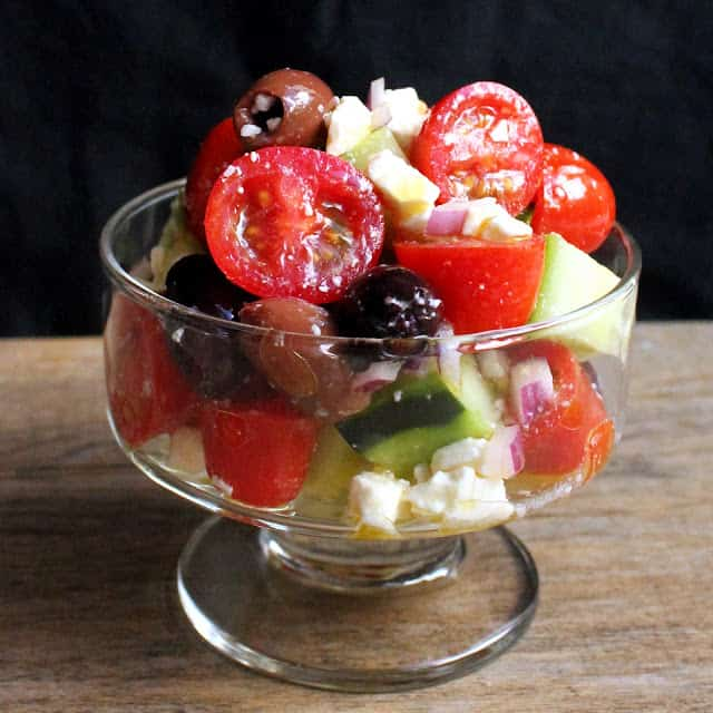 Glass bowl filled with greek salad