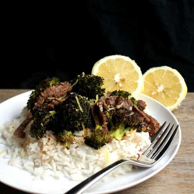 Lemon Ginger Beef and Broccoli served over white rice on a white plate