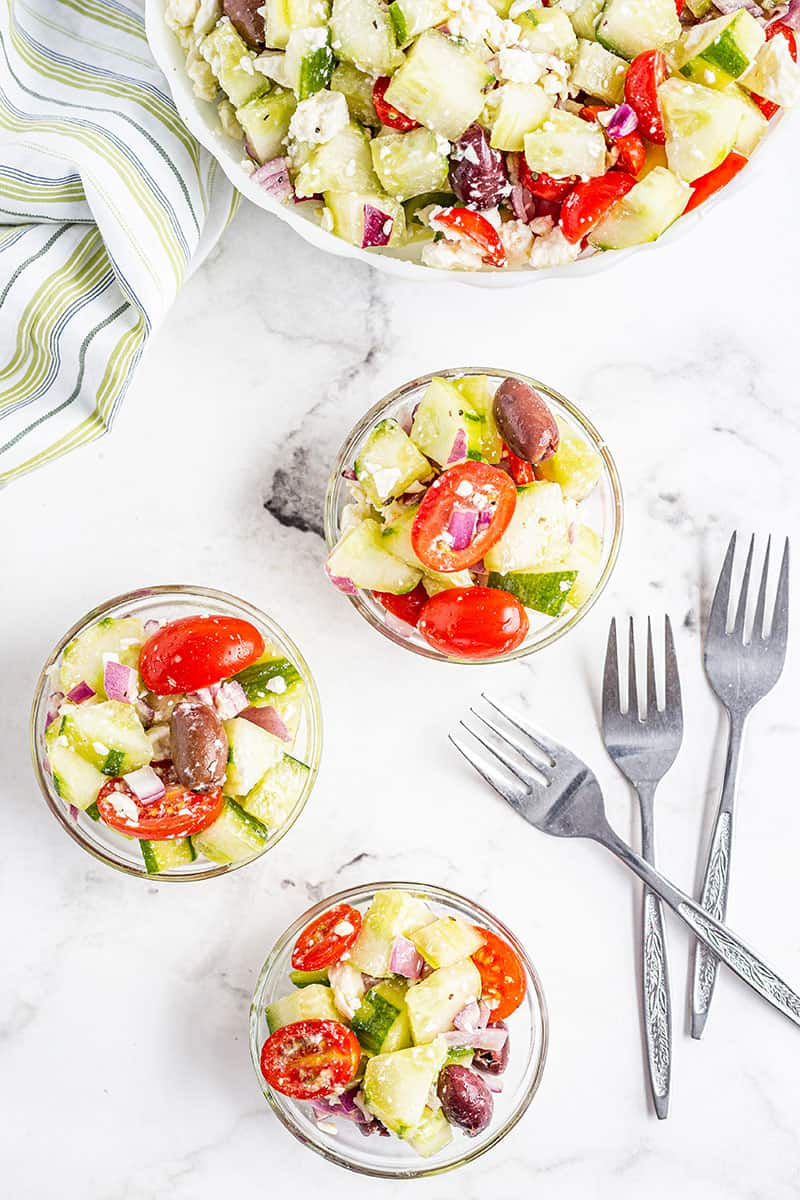 small serving bowls of greek salad