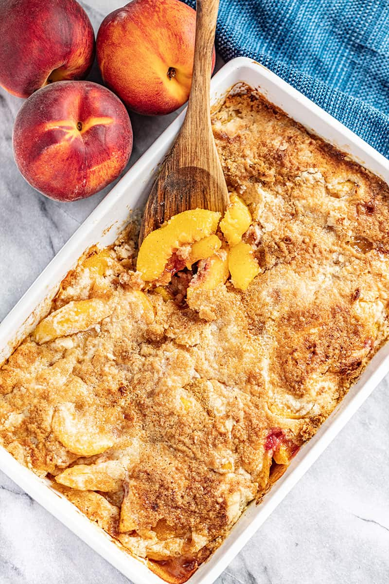 Peach Dump Cake is a family favorite summertime dessert made entirely from scratch with just a handful of simple ingredients. The recipe includes instructions for frozen, fresh, or canned peaches. No box cake mix needed!