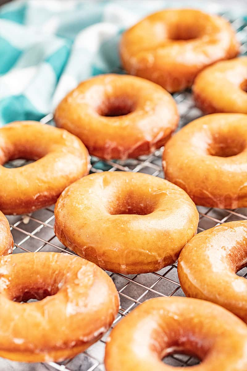 Glazed donuts on a cooling rack
