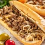 a Philly cheesesteak open to expose the meat and cheese and onions