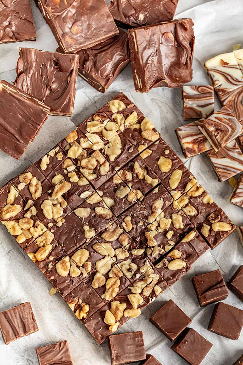cut up homemade fudge with nuts.