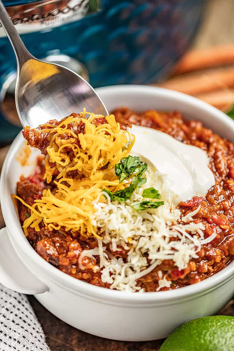 A spoon dipping into a bowl of Texas Chili.