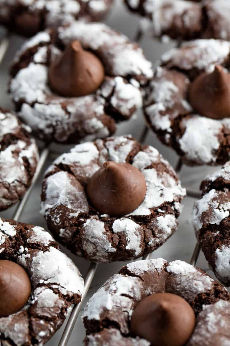 Chocolate kiss cookies on a wire cooling rack