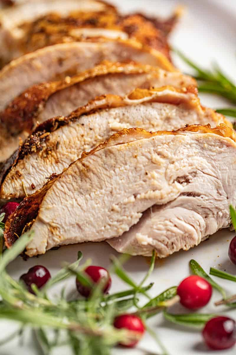 a sliced oven roasted turkey breast.