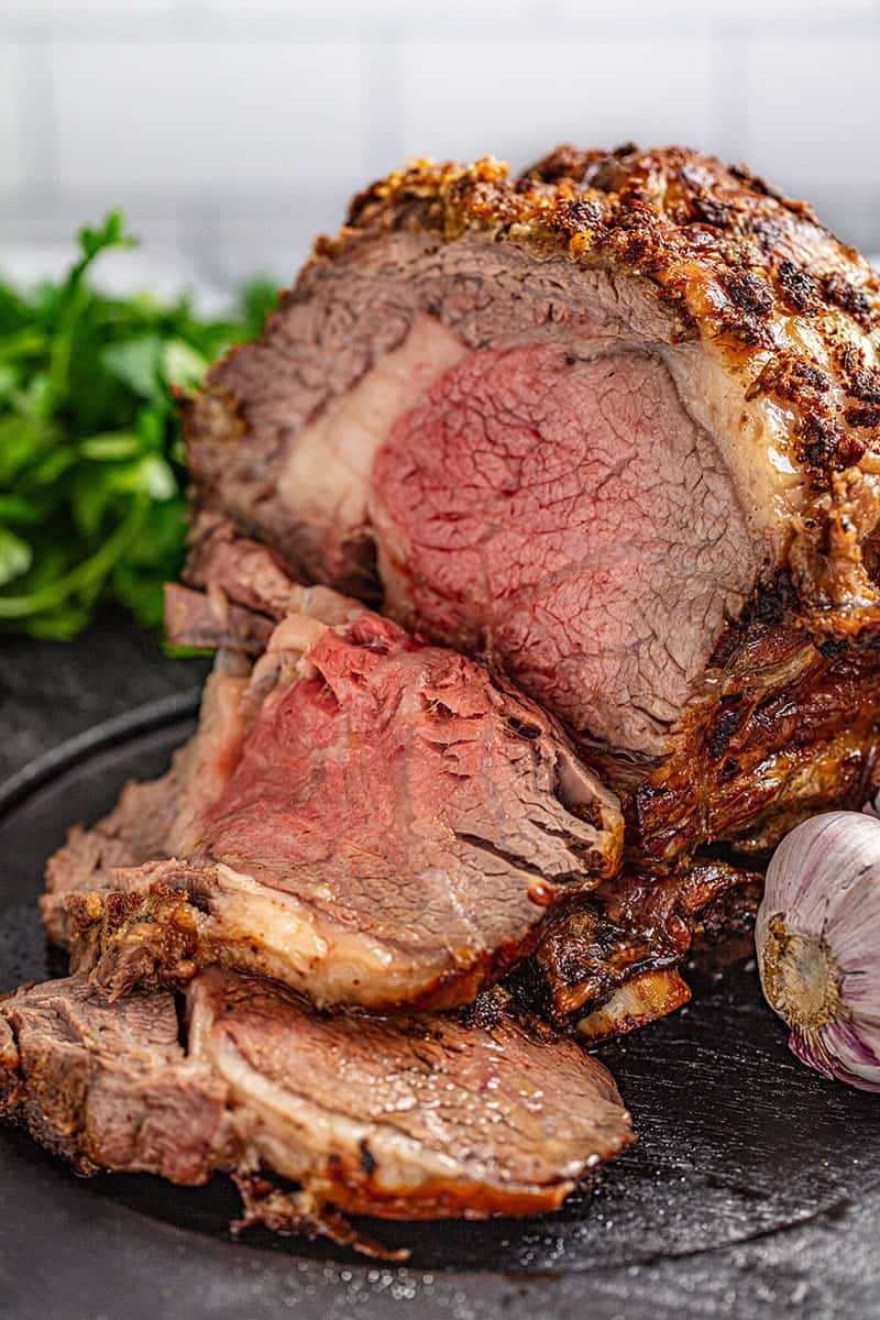 a slice of horseradish crusted prime rib cut off from the roast.