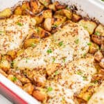 Honey dijon chicken and potatoes in a baking dish.