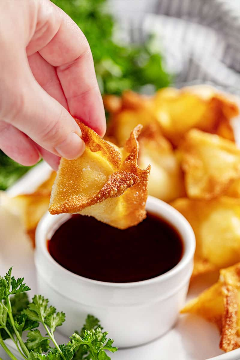 A cream cheese wonton and sweet and sour sauce.