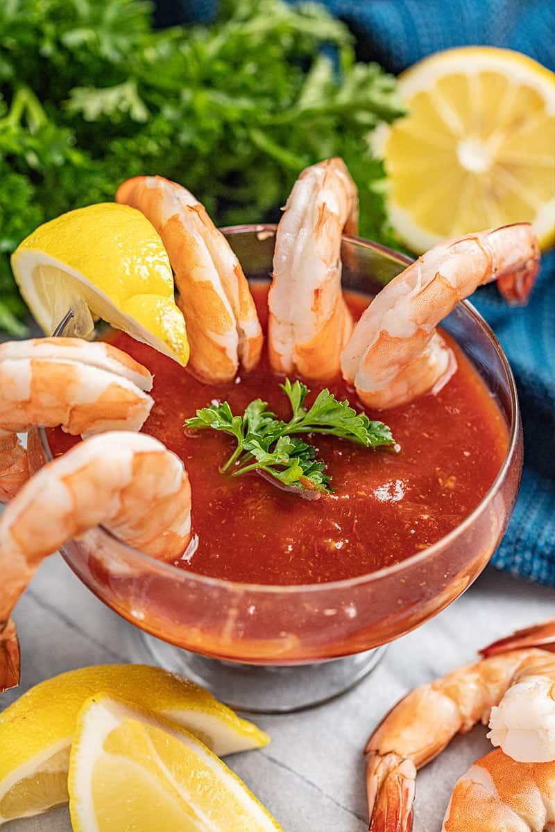 Shrimp Cocktail hanging over a glass.
