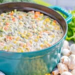 Creamy vegetable soup in a pot.