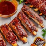 A rack of separated oven baked ribs.