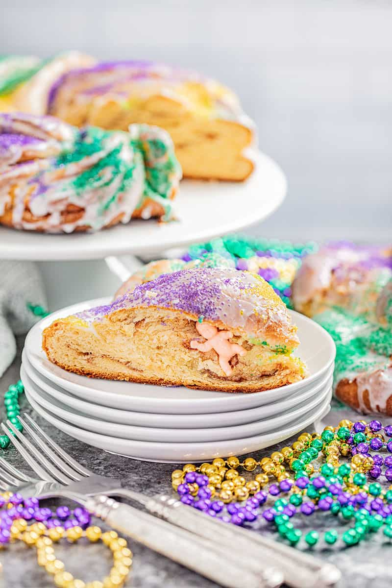 King cake with one slice removed.
