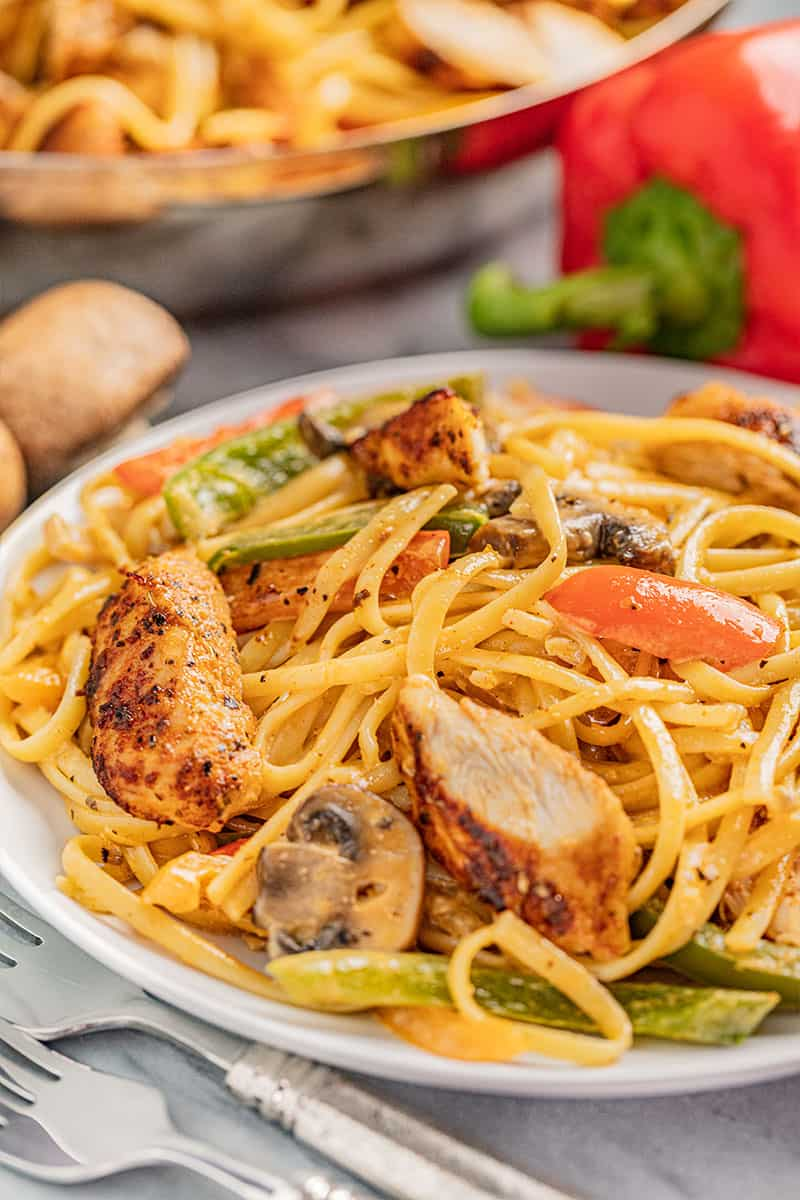 a serving plate of cajun chicken pasta.