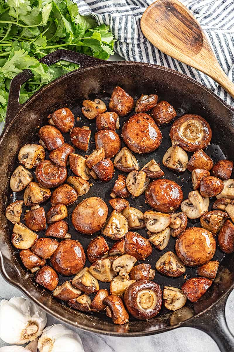 Overhead view of sautéed mushrooms.