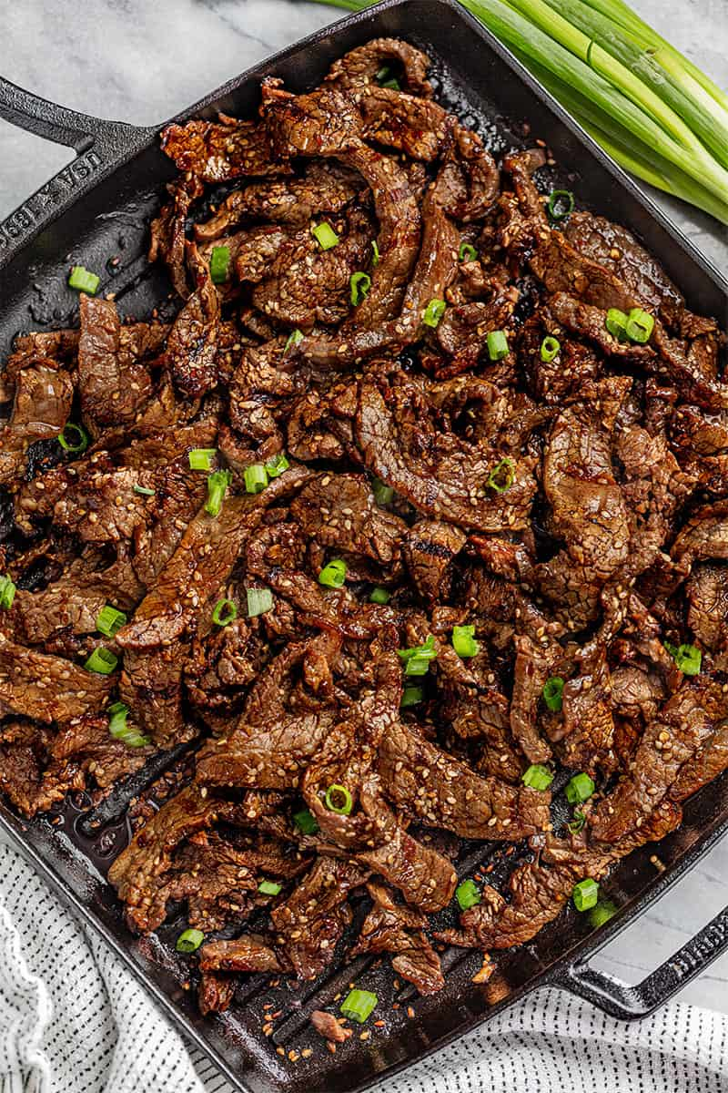 Korean Beef Bulgogi in a cast iron skillet.