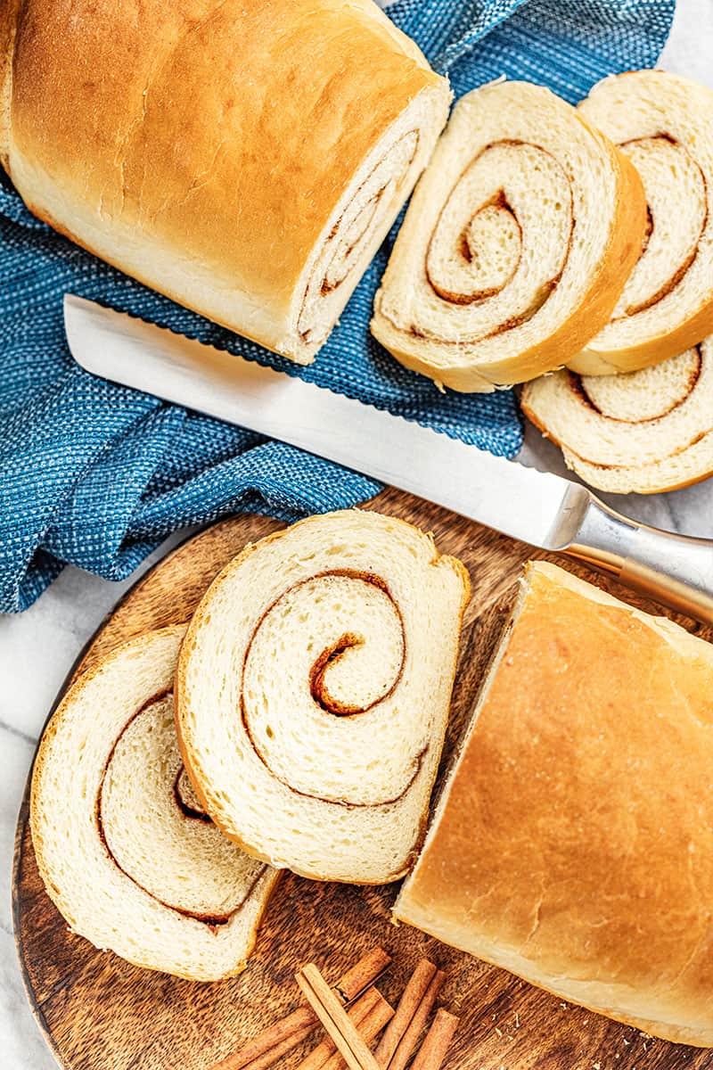Overhead view of 2 cut loaves of cinnamon swirl bread.
