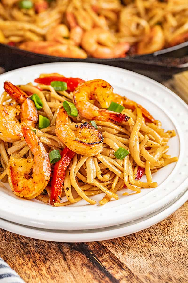 Creamy cajun shrimp pasta on a dinner plate.