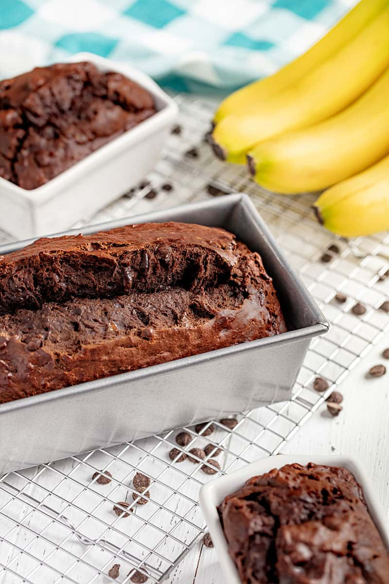 A loaf of chocolate banana bread in a bread pan.