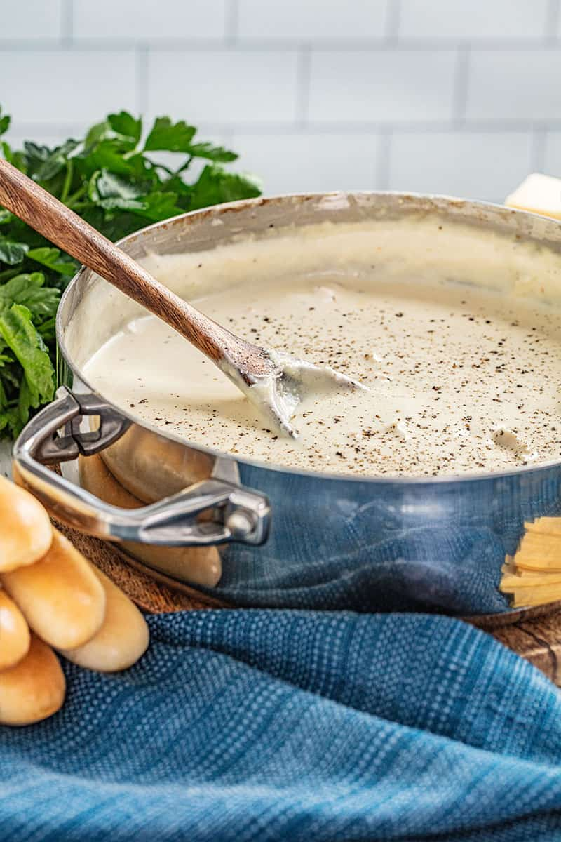 Classic chicken alfredo in a pan.